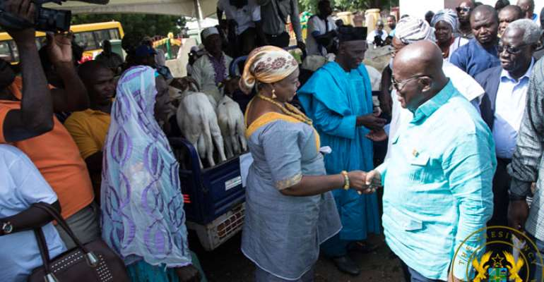 President Akufo-Addo interacting with one of the farmers at the event