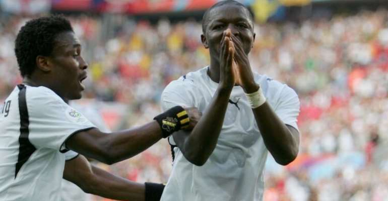 COLOGNE, GERMANY - JUNE 17: Sulley Muntari (11) of Ghana celebrates with team mate Derek Boateng (9) afetr scoring the second goal of the game during the FIFA World Cup Germany 2006 Group E match between Czech Republic and Ghana at the Stadium Colonge on June 17, 2006 in Colonge, Germany. (Photo by Jamie McDonald/Getty Images)