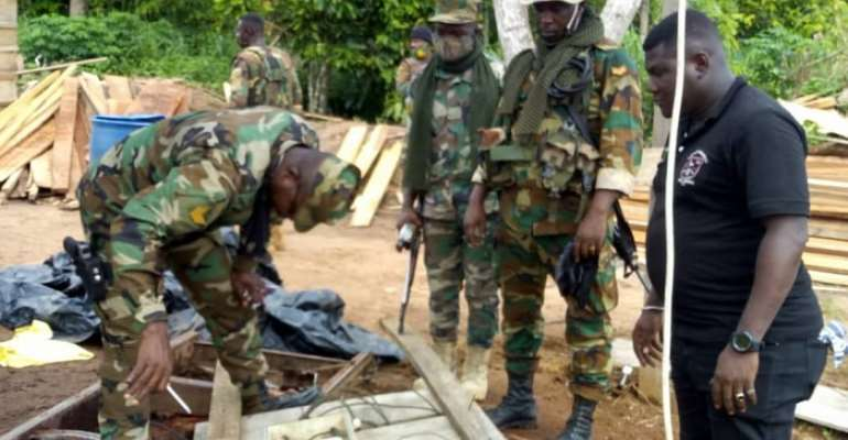 Soldiers attached to the taskforce trying to dismantle a machine at an