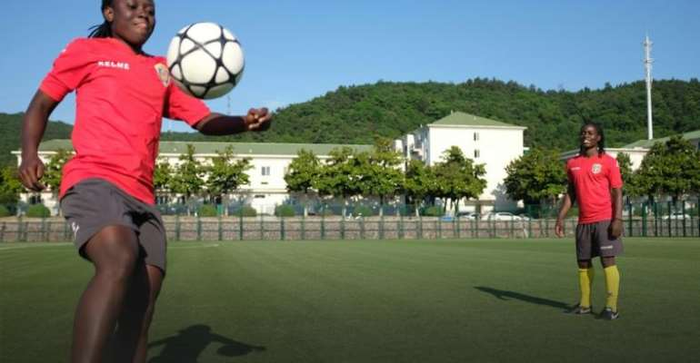 African 'Twin Sisters' Tackle Chinese Football Together