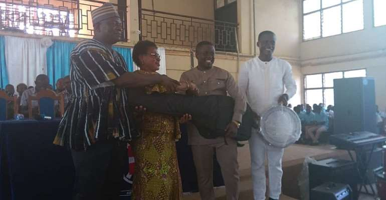 Municipal Education Director receives items from the Hon Benjamin Yeboah Sekyere