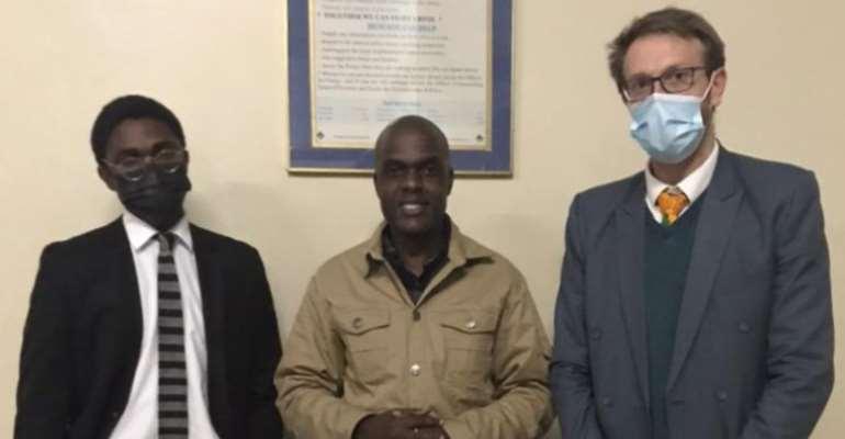 New York Times freelance journalist Jeffrey Moyo, flanked by his defense lawyers, Zangelo Mlilo (left) and Doug Coltart (right), is seen in Bulawayo, Zimbabwe, on May 27, 2021. (Photo: Doug Coltart)
