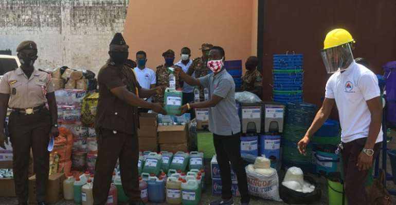 Jonathan Osei Owusu making the donations to DSP Adamu Abdul Latif