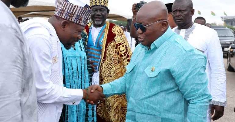 President Akufo-Addo (R) in a handshake with Aziz Harunah Futah (L)