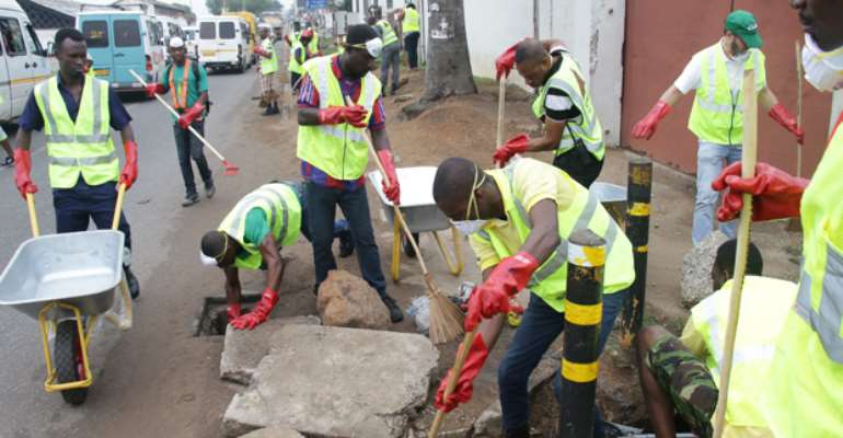 Some ABL employees and Adabraka residents desilting a drain