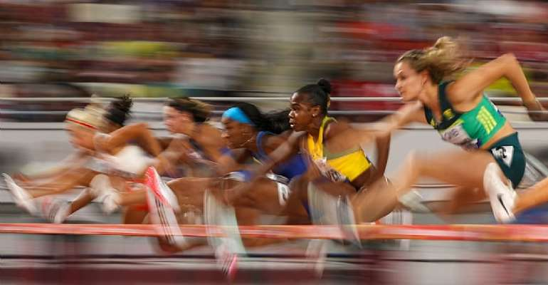 Megan Tapper of Jamaica competes in the Women's 100 metres hurdles semi finals during the 17th IAAF World Athletics Championships Doha 2019. (Photo by Patrick Smith/Getty Images)
