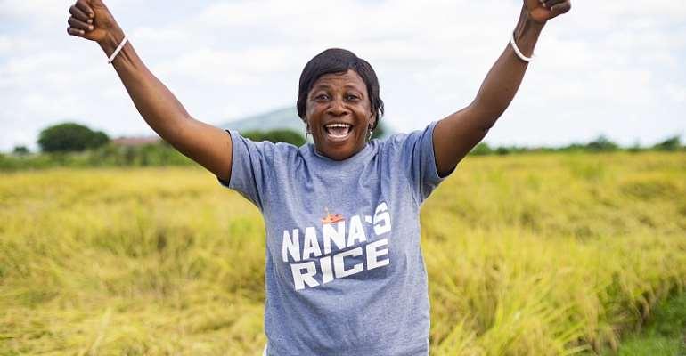 Meet Madam Regina, a happy rice farmer