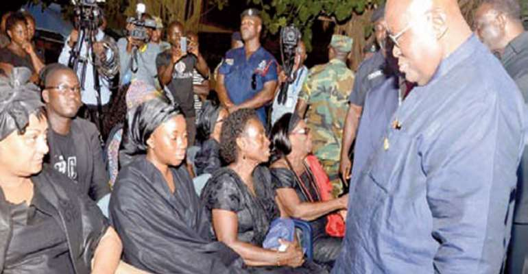 Nana Addo consoling the wife of the deceased, Barbara Mahama