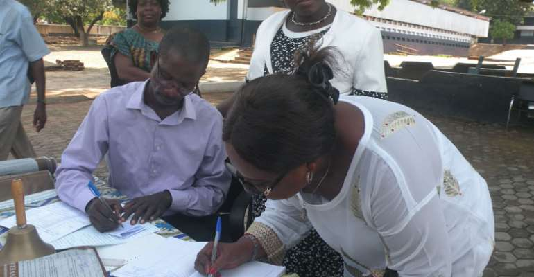 The MCE signing the visiter's book at the Garrison Centre