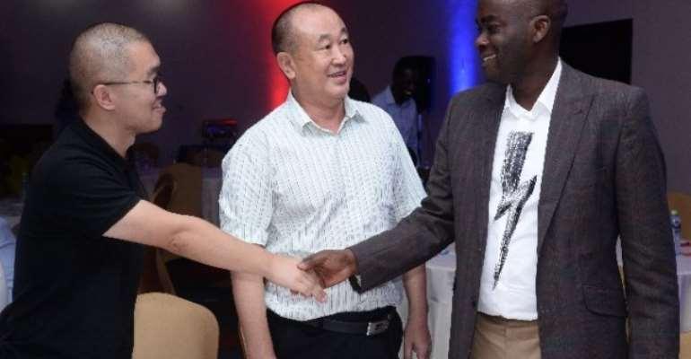 Olumide Olatunji, MD of Access Bank Ghana interacting with James Yin, Secretary of Chinese Traders Association