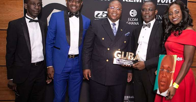 Dr. Nii Kotei Dzani (middle) being presented with his award