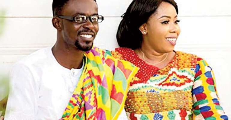 Nana Appiah Mensah aka NAM 1 and his wife, Rose