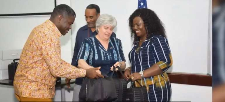 A screenshot from the YouTube channel of the U.S. Embassy in Ghana shows Ambassador Stephanie Sullivan, center, handing over Cellebrite technology to Gustav Yankson, left, director of the Ghana police cybercrime unit of the Criminal Investigation Department, and Maame Yaa Tiwaa Addo-Danquah, right, former director general of Ghana police CID. Journalists are wary that phone hacking technology could affect their safety or that of their sources