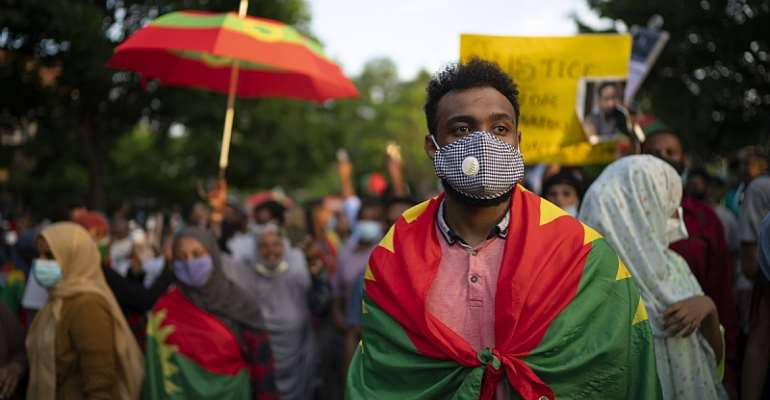 Demonstrators protesting the political situation in Ethiopia in the wake of the death of musician Hachalu Hundessa  - Source: Jeff Wheeler/Star Tribune via Getty Images
