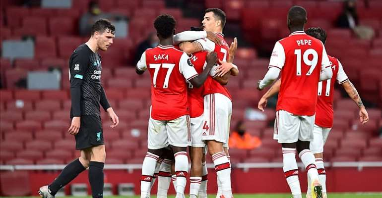 Reiss Nelson of Arsenal celebrates with teammates after scoring his sides second goal during the Premier League match between Arsenal FC and Liverpool FC at Emirates Stadium on July 15, 2020 in London, England.  Image credit: Getty Images