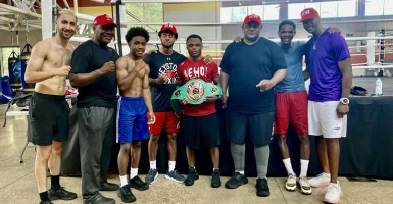 Isaac Dogboe receives his NABF Featherweight title