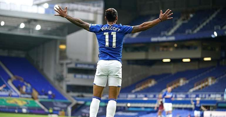 Theo Walcott of Everton celebrates after scoring his sides first goal during the Premier League match between Everton FC and Aston Villa at Goodison Park on July 16, 2020 in Liverpool, England. Football Stadiums around Europe remain empty due to the Coron  Image credit: Getty Images
