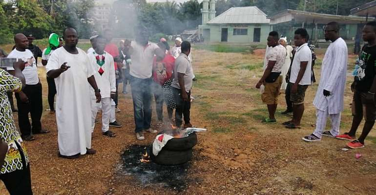 Asawase NDC: Supporters Of Muntaka's Contender Burn Tyres, Posters