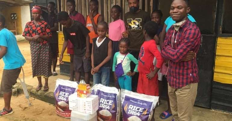 Mohammed Kerkulah Of YALDA Liberia (Far Right) With Some Beneficiaries Of Items At One Of The Orphanages They Made Donations To
