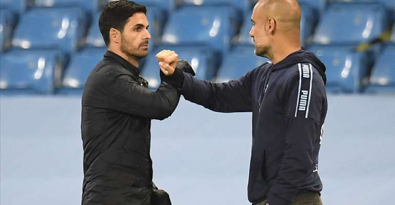 Mikel Arteta and Pep Guardiola bump elbows
