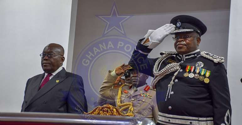 President Akufo-Addo [Left] with outgoing IGP James Oppong-Boanuh [Right]