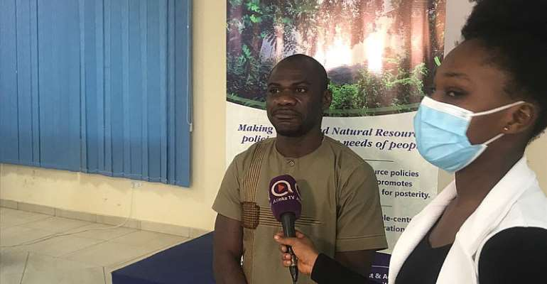 Managing campaigner for EcoCare Ghana, Obed Owusu-Addai  engaging the media after the programme