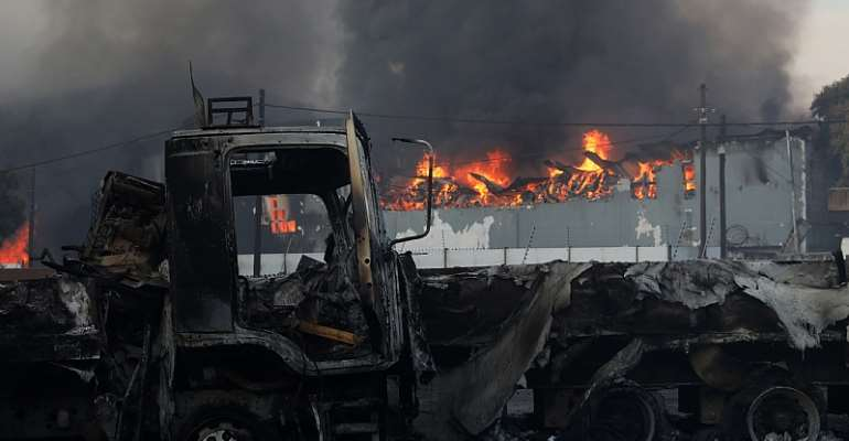 Trucks and business were looted and burnt during recent riots in South Africa.  - Source: EPA-EFE/Stringer
