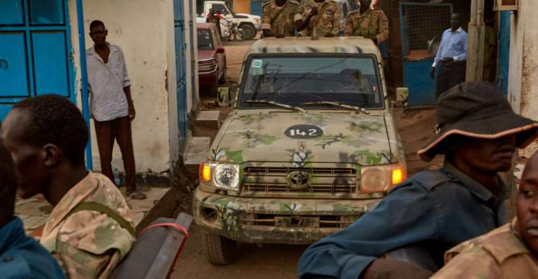 Security forces are seen in Juba, South Sudan, on April 9, 2020. Authorities recently detained journalist Alfred Angasi and have held him for weeks without charge. (AFP/Alex McBride)