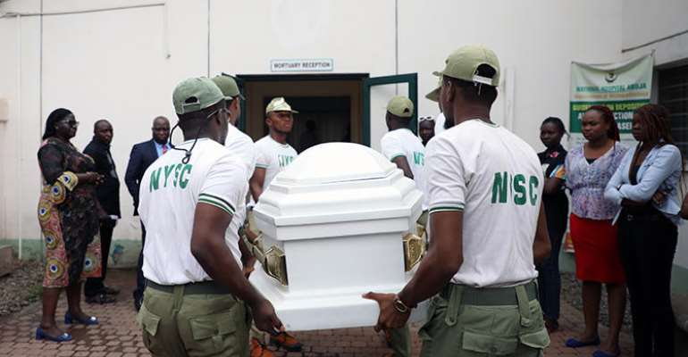 Members of the National Youth Service Corp carry the body of their colleague, the reporter Precious Owolabi, in Abuja on July 23. Owolabi was shot while covering protests in the Nigeria capital. (AFP/Kola Sulaimon)