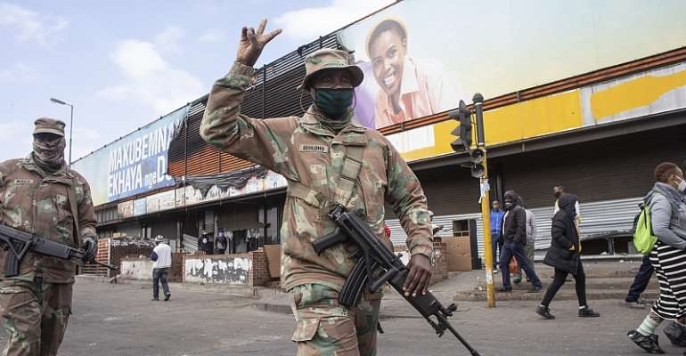 South African Defence Force troops on patrol in Alexandra, Johannesburg, following recent violence and looting.  - Source: EFE-EPA/Kim Ludbrook