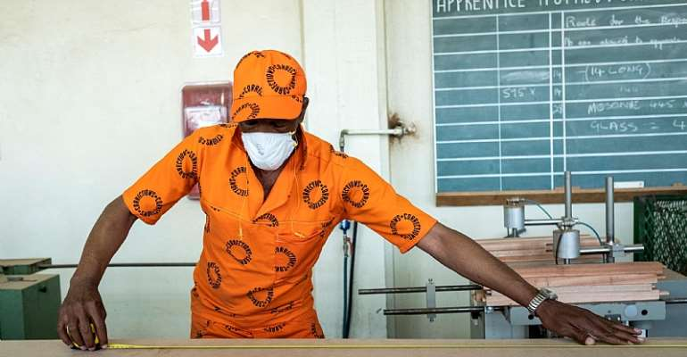 An inmate busy in the woodwork area of The Leeuwkop Correctional Facility. - Source: WIKUS DE WET/AFP via Getty Images