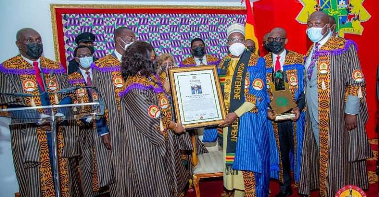 Speaker receives his citation on the floor of Parliament