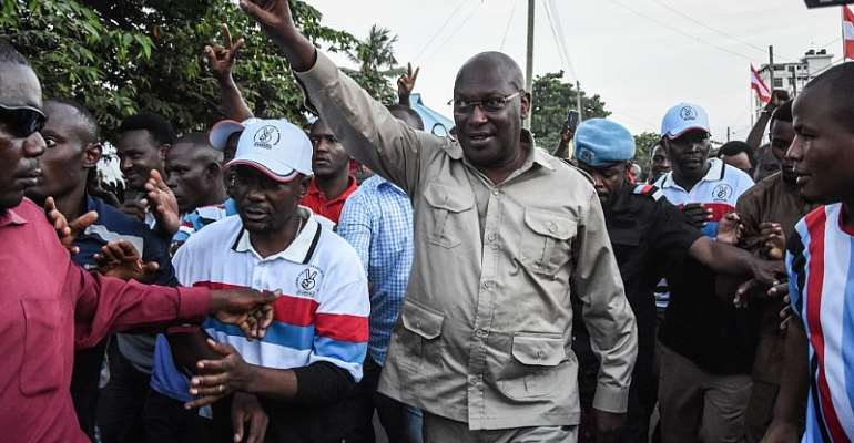 Tanzania opposition party leader Freeman Mbowe (centre) after being released from prison in Dar es Salaam in 2020.     - Source: Photo by Ericky Boniphace/AFP via Getty Images
