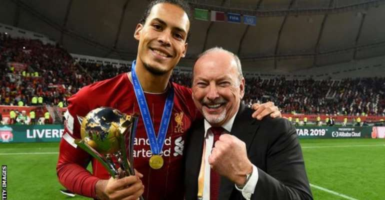 Moore (right) celebrates with defender Virgil van Dijk after the Fifa Club World Cup win over Flamengo in December