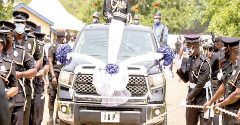 Senior Police Officers pulling out the IGP from active service