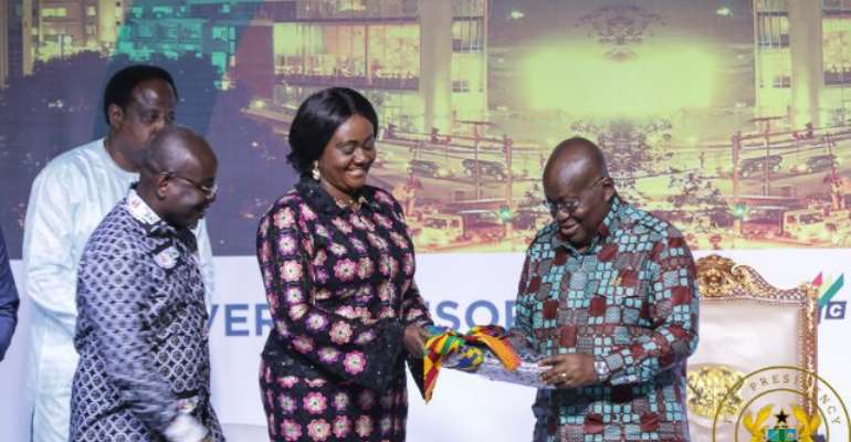 President AKufo-Addo receiving an award from Ministry of Tourism.