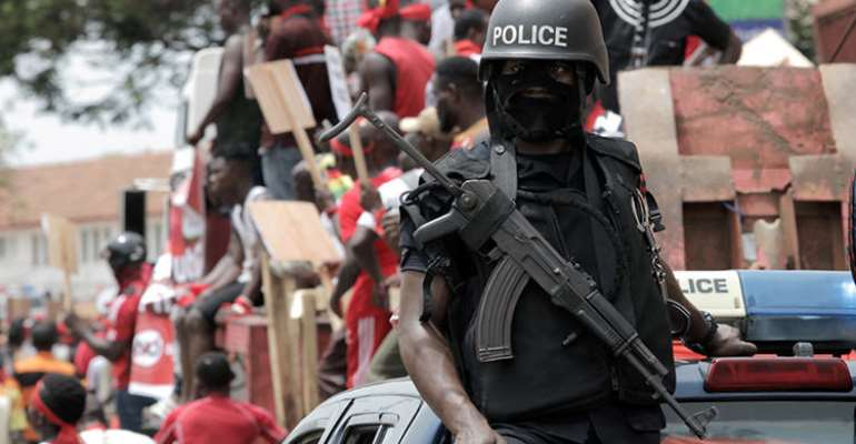 A police officer is seen in Accra, Ghana, on March 28, 2018. Modern Ghana editor Emmanuel Ajarfor and reporter Emmanuel Britwum were recently arrested, and Ajarfor was allegedly tortured by security forces, in Accra. (Reuters/Francis Kokoroko)
