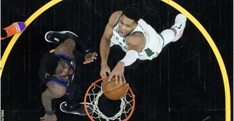 Bucks' Antetokounmpo (right) returned from a knee injury to score 20 points in the first game of the NBA Finals