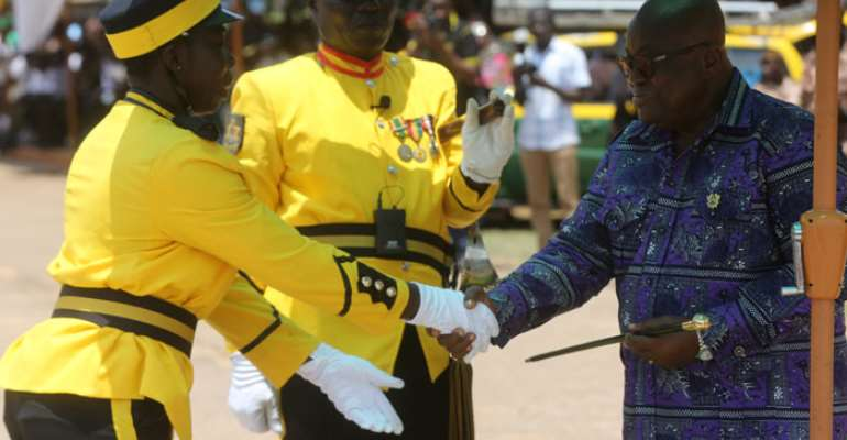 President Akufo-Addo presenting a Commandant Award to JUO Asomaning Mabel.
