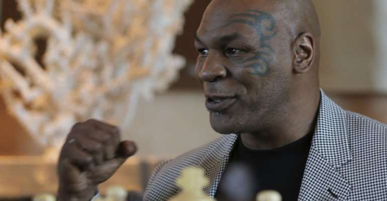 Fans will have to wait a little bit longer to see Mike Tyson step back into the ring. (AP/Kamran Jebreili)