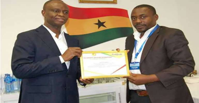 Mr. Joe Anokye (L) receiving a certificate of recognition from Mr Yahaya Alhassan (R)