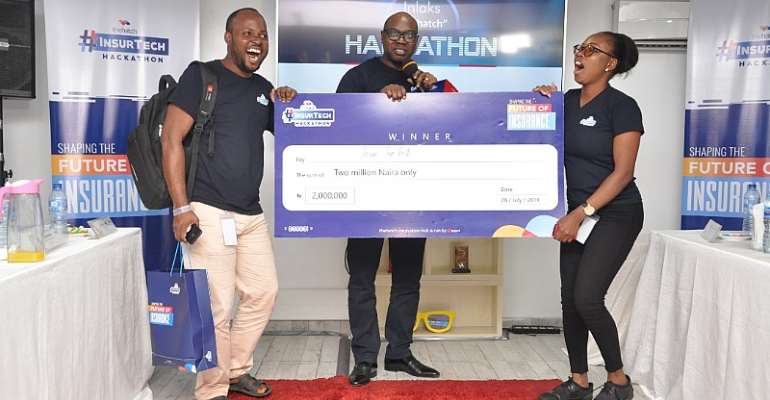 Team Lead, Team TopHill, Oni Joseph; Managing Director, Inlaks, Africa Operations, Femi Adeoti; and Team Member, Team Tophill, Omondia Vester, being presented the winning prize