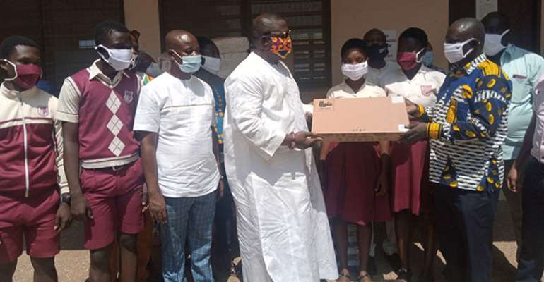 Joseph Nii Laryea Afotey-Agbo presenting the items to the headmaster