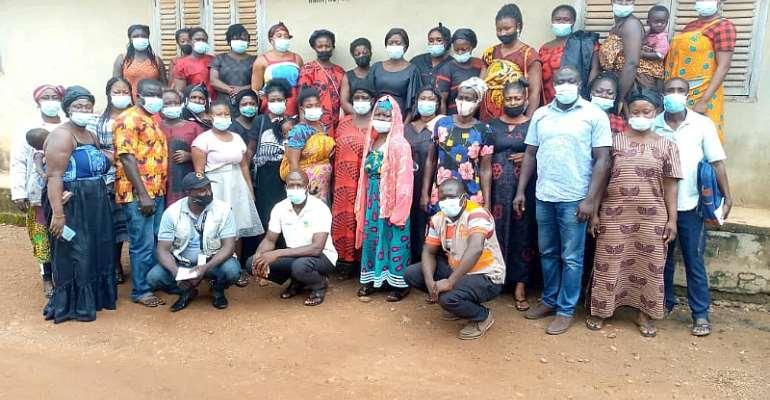 A group photograph of Wacam VSLA group in Kenyasi members and CARE International in Ghana monitoring team