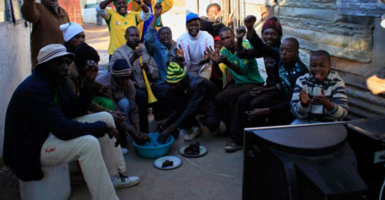South African Football Fans Cheer On From Home