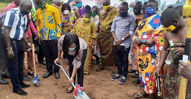 Representatives of the Chief of Staff and other dignitaries cutting sod for the project to start