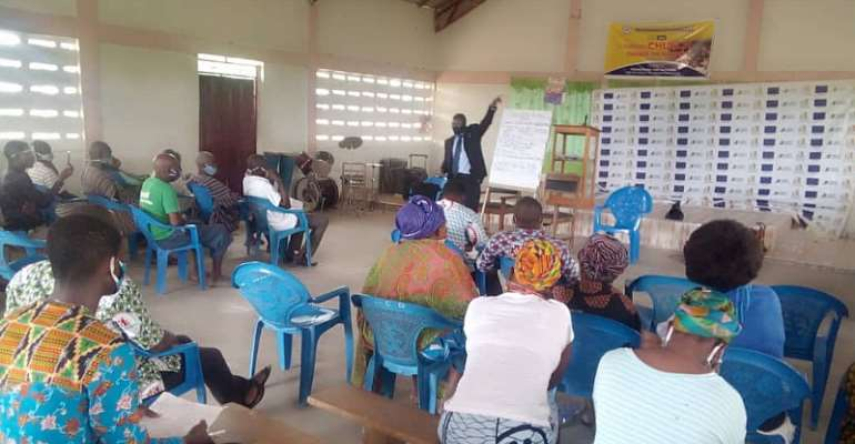 Mr. Yeboah (Facing Camera) Stressing A Point to participants