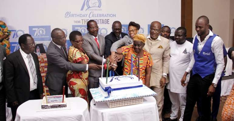 GJA Executives and dignitaries cutting the birthday cake