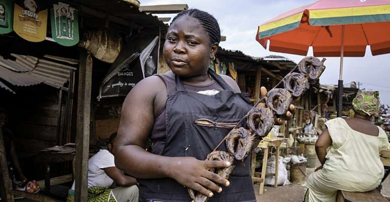Woman selling dried fish at the Benin City market. - Source: Jorge Fernández/LightRocket via Getty Images