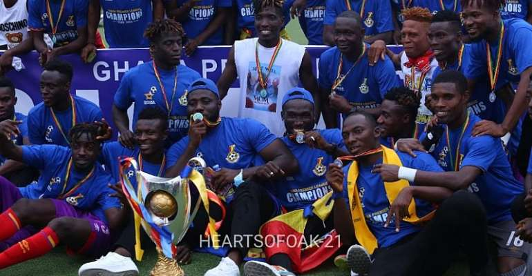 Players of Accra Hearts of Oak displaying the league trophy after their coronation